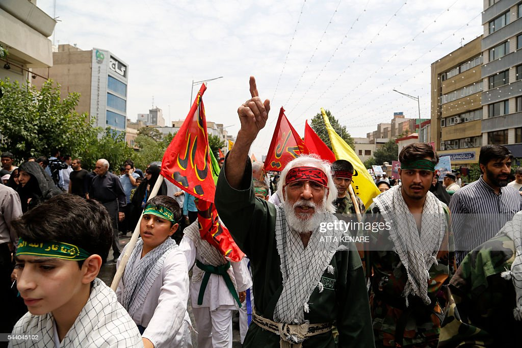 Iranian protesters shout slogans during a parade marking al-Quds (Jerusalem) Day in Tehran on July 01, 2016. Tens of thousands joined pro-Palestinian rallies in Tehran, as the annual Quds Day protests take on broader meaning for a region mired in bitter disputes and war. / AFP / ATTA