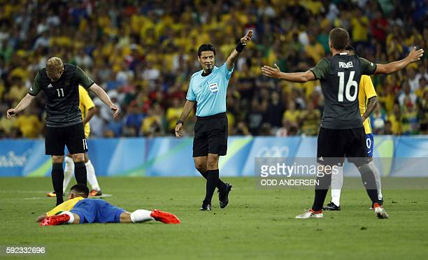 Iranian referee Alireza Faghani reacdts after a foul during the Rio 2016 Olympic Games men's football gold medal match between Brazil and Germany at...