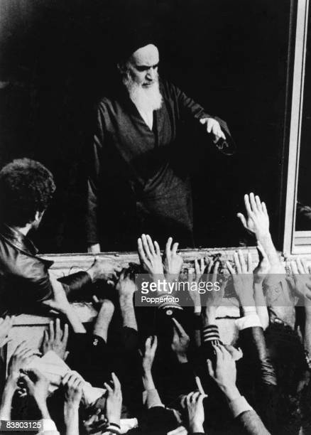 Iranian religious and political leader Ayatollah Ruhollah Musavi Khomeini greets a group of his followers Iran 1979