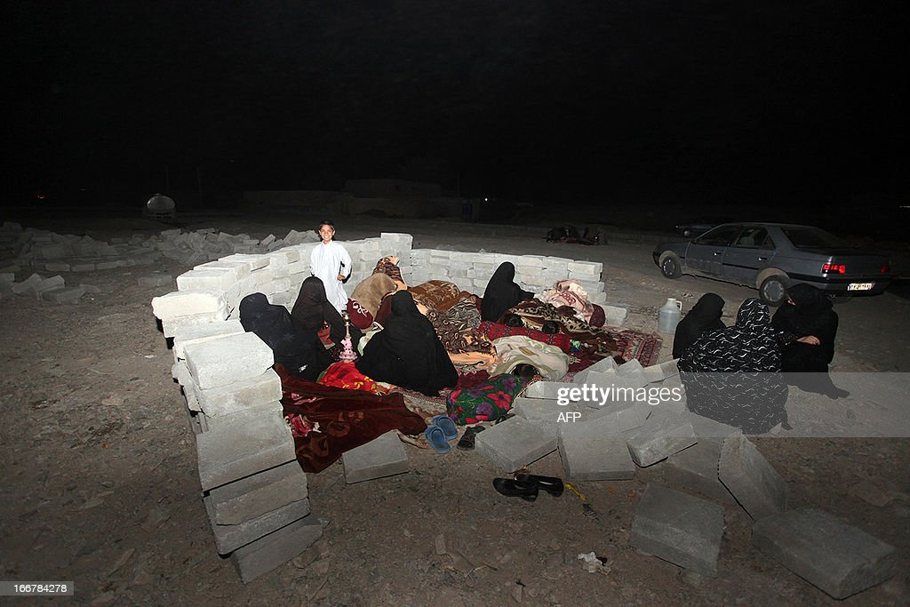 Iranian residents take shelter in a field after an earthquake hit the city of Saravan, in Sistan-Beluchistan province, in south-eastern Iran on April 16, 2013. The 7.5-magnitude quake damaged more than 1,000 mud houses in the town of Mashkail in Pakistan's remote Baluchistan province, close to the desert border with Iran. AFP PHOTO/MEHR NEWS/HAMID SADEGHI