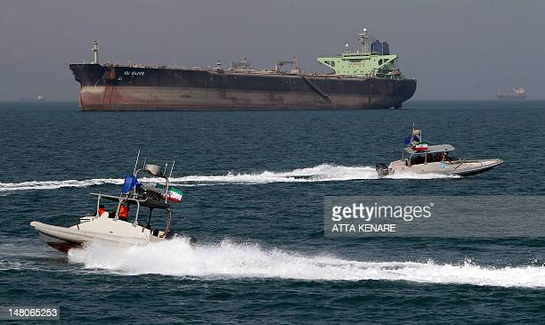 Iranian Revolutionary Guard speedboats cruise past an oil tanker off the port of Bandar Abbas southern Iran on July 2 2012 Iran has come up with...