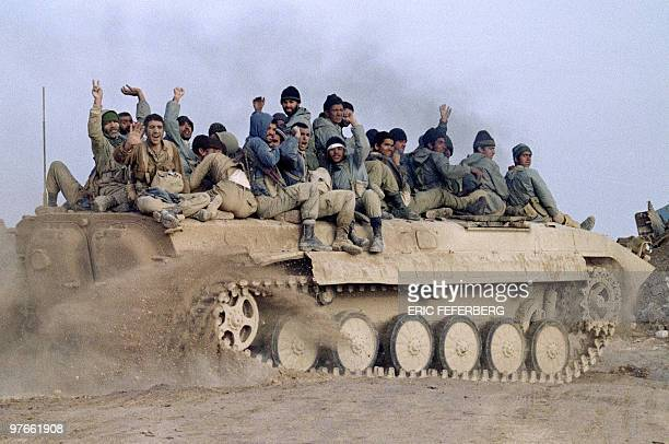 Iranian revolutionary guards seated on an armored personnel carrier celebrate their victory over Iraqi troops 24 January 1987 in Bovarian Island Iraq...