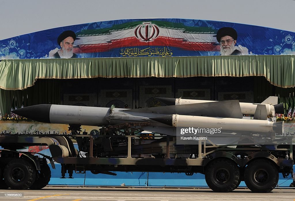 Iranian Revolutionary Guardsand IRGC Major General Hassan Firoozabadi alongside other military commanders observes ballistic missiles during a parade commemorating the 31st anniversary of Iran-Iraq war on September 22, 2011 in Tehran, Iran. Iran is holding military parades in Tehran and other parts of the country on the first day of the Sacred Defence Week. Tehran's parade began to the north of Imam Khomeini's mausoleum providing the army, Islamic Revolution Guards Corps, Law Enforcement Force and Basij with an opportunity to display their state of military preparedness, in which armaments and indigenously built military equipment including Shahab missiles, unmanned aircrafts, Zulfaqar tanks, and a variety of rapid fire machine guns were showcased.