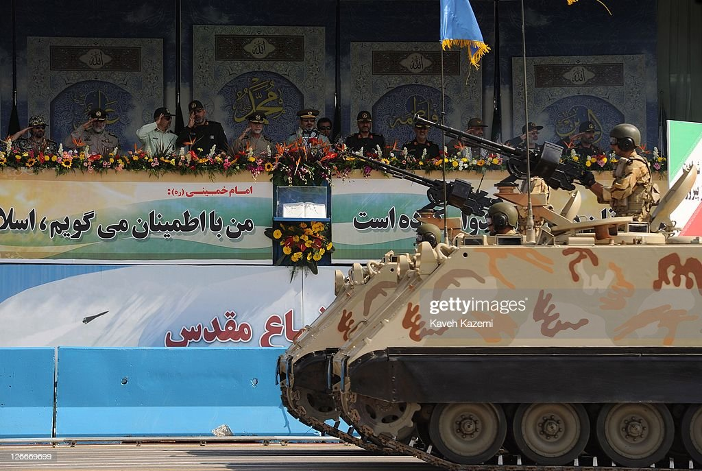 Iranian Revolutionary Guardsand IRGC Major General Hassan Firoozabadi alongside other military commanders observes armoured vehicles during a parade commemorating the 31st anniversary of Iran-Iraq war on September 22, 2011 in Tehran, Iran. Iran is holding military parades in Tehran and other parts of the country on the first day of the Sacred Defence Week. Tehran's parade began to the north of Imam Khomeini's mausoleum providing the army, Islamic Revolution Guards Corps, Law Enforcement Force and Basij with an opportunity to display their state of military preparedness, in which armaments and indigenously built military equipment including Shahab missiles, unmanned aircrafts, Zulfaqar tanks, and a variety of rapid fire machine guns were showcased.