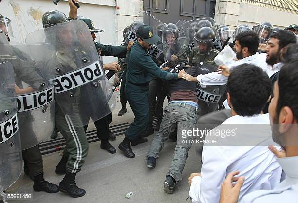 Iranian riotpolice clash with demonstrators as they protest against the earlier threats by a US pastor Terry Jones to burn copies of the Muslim holy...