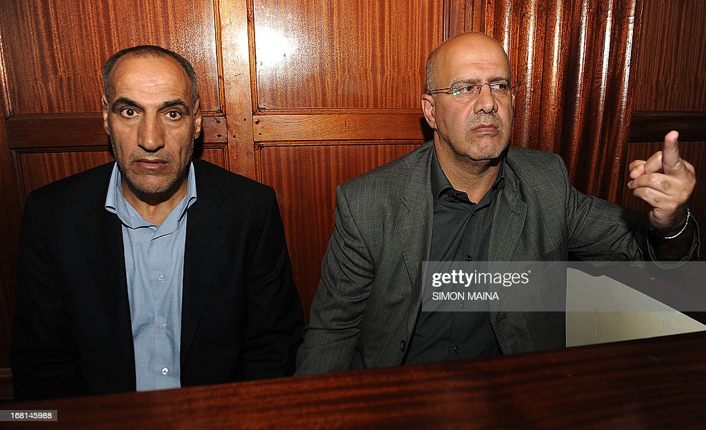 Iranian Sayed Mansour Mousavi (L) sits next to Ahmad Abolfathi Mohammed as he gestures after being sentenced to life in prison on terror-related charges, including the possession of explosives allegedly for use in bomb attacks, on May 6, 2013 during their trial in Nairobi. A Kenyan court sentenced the two Iranians to life in prison on terror-related charges, including the possession of explosives allegedly to be used in bomb attacks. 'I shudder to imagine the amount of damage that could have been seen,' judge Kiarie Waweru Kiarie told the court in the capital Nairobi.