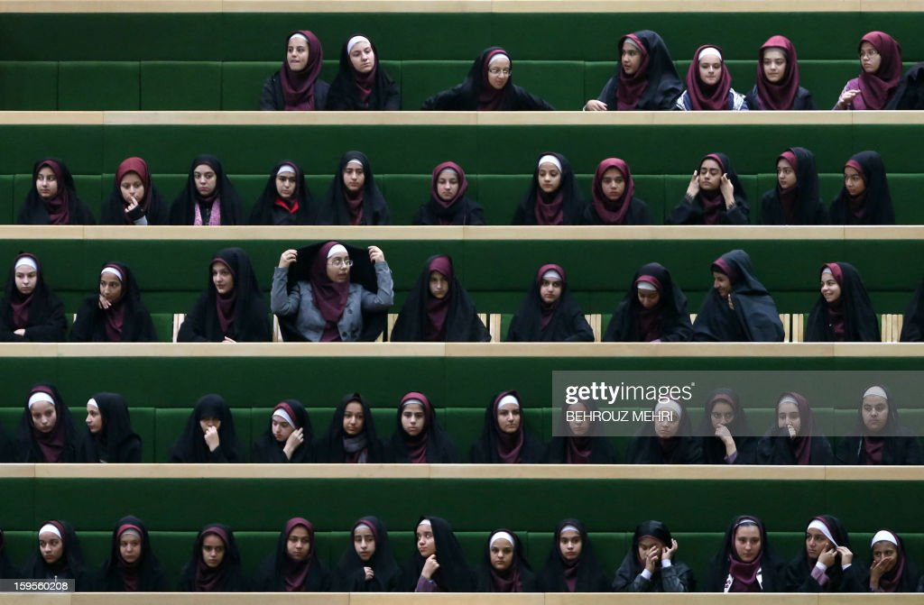 Iranian schoolgirls attend a parliament session to listen to the speech of President Mahmoud Ahmadinejad on the county's economic situation in Tehran on January 16, 2013. Experts from the International Atomic Energy Agency (IAEA) arrived in Tehran to try resolve long-running differences with Iran over its controversial nuclear programme. AFP PHOTO/BEHROUZ MEHRI