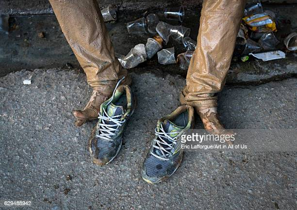 Iranian shiite muslim man legs and shoes after rubbing mud on his clothes during the Kharrah Mali ritual to mark the Ashura ceremony Lorestan...