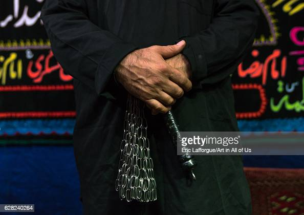 Iranian shiite muslim man with iron chains to commemorate Ashura Central County Theran Iran on October 7 2016 in Theran Iran