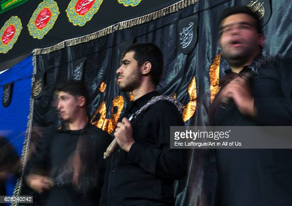 Iranian shiite muslim men beating themselves with iron chains to commemorate Ashura Central County Theran Iran on October 7 2016 in Theran Iran