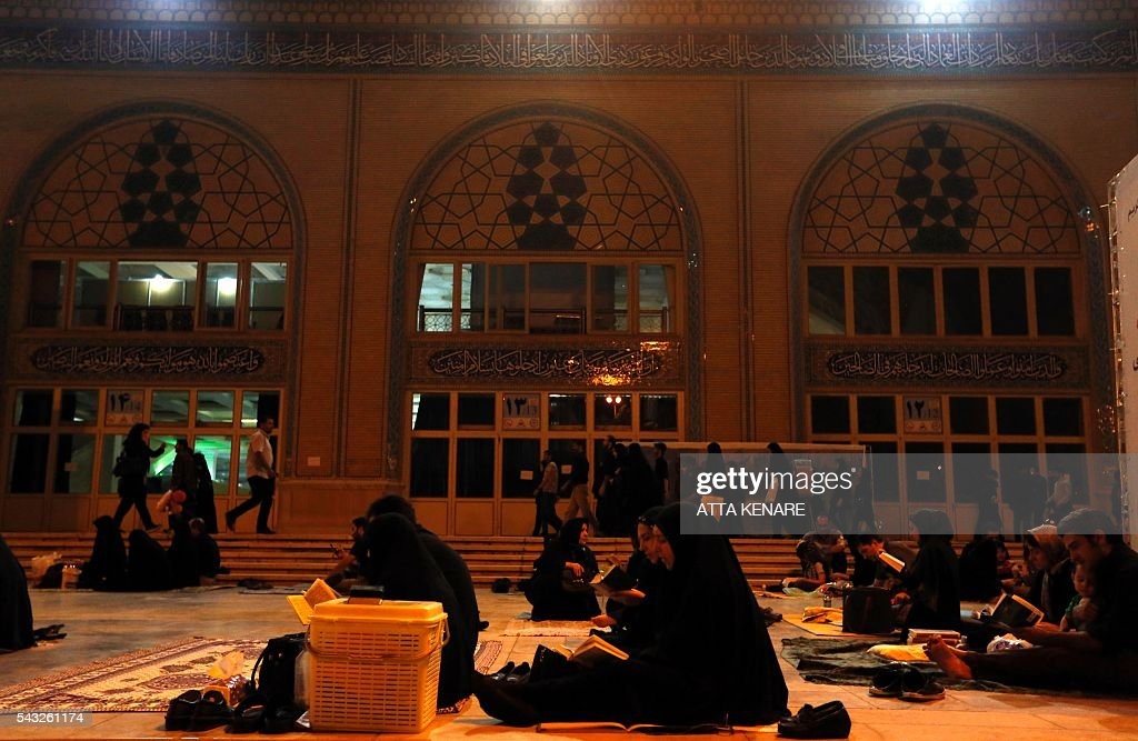 Iranian Shiite Muslim women pray at the Imam Khomeini grand mosque in the capital Tehran in the early hours of July 27, 2016 in commemoration of the death of the seventh century Imam Ali bin Abi-Taleb and in preparation for Laylat al-Qadr -- a high point during Ramadan when the Koran, Islam's holy book, was revealed to Prophet Mohammed by archangel Gabriel. Imam Ali is the first Shiite Imam and fourth caliph to succeed Prophet Mohammed, his cousin and father-in-law. / AFP / ATTA