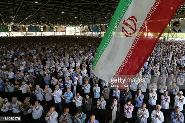 Iranian Shiite Muslim worshipers attend the weekly Friday prayers on July 17 at the University of Tehran AFP PHOTO / ATTA KENARE