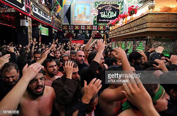 Iranian Shiite Muslims beat their heads and chests during Ashura rituals at Tehran's Karbalaiya Mosque on November 14 as they mark the 7th century...