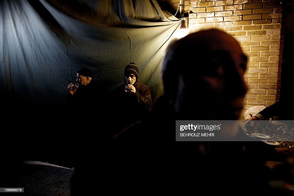 Iranian Shiite Muslims drink tea at Tehran's Grand Bazaar, on January 3, 2013 during the Arbaeen religious festival which marks the 40th day after Ashura, commemorating the seventh century killing of Prophet Mohammed's grandson, Imam Hussein.
