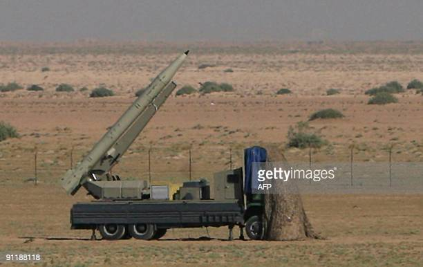Iranian shortrange missile is prepared to be testlaunched during war games in Qom 120 kms south of Tehran on September 27 2009 Iran testfired three...