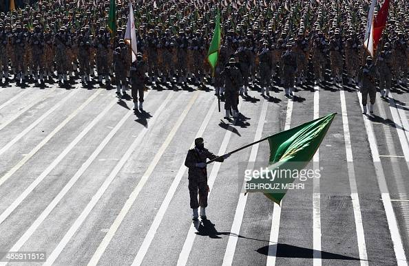 Iranian soldiers from the Revolutionary Guards march during the annual military parade marking the anniversary of Iran's war with Iraq in Tehran on...