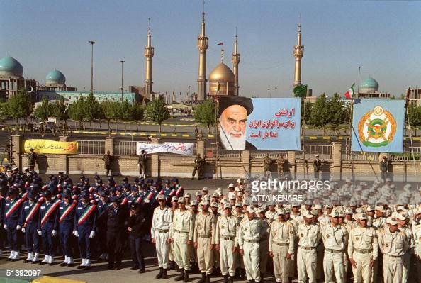 Iranian soldiers take part in a parade held to mark the national army day 18 April 2001 in front of the golden dome and minarets of the mausoleum of...
