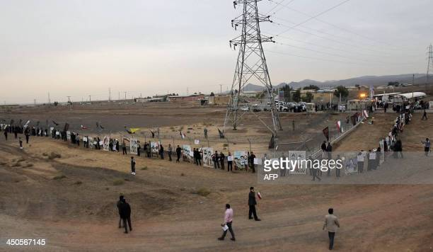 Iranian students form a human chain during a protest to defend their country's nuclear program outside the Fordo Uranium Conversion Facility in Qom...