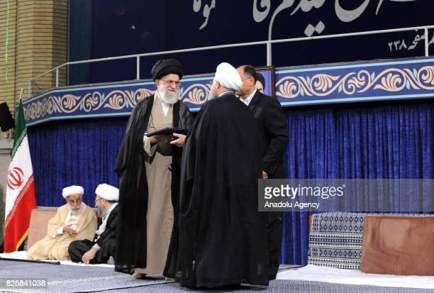 Iranian Supreme Leader Ali Khamenei presents his official approval to Hassan Rouhani who was reelected in presidential elections on May 2017 during a...