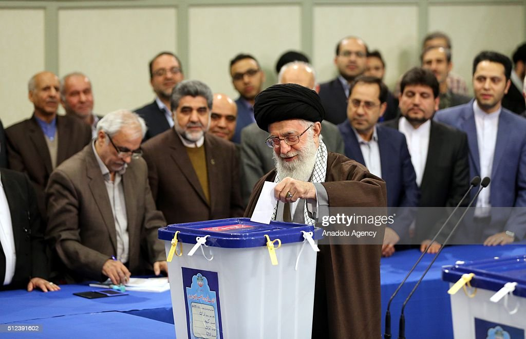 Iranian Supreme Leader Ayatollah Ali Khamenei casts his ballot for both parliamentary elections and the Assembly of Experts at a polling station in...