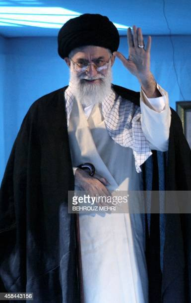 Iranian supreme leader Ayatollah Ali Khamenei waves to the crowd following his speech during a ceremony marking the 15th anniversary of the death of...