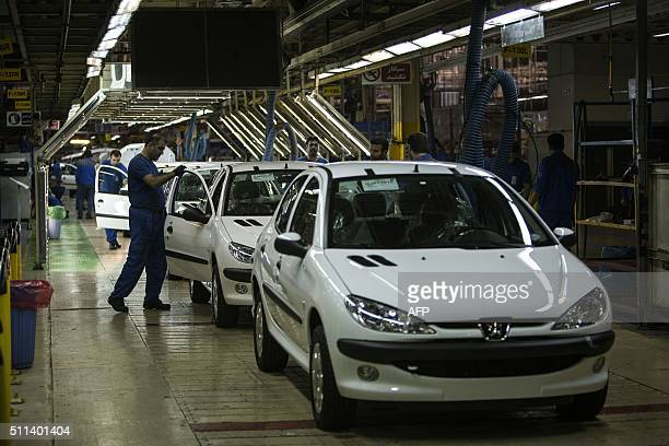 Iranian technicians check on Peugeot 206 cars on the final production line at the Iran Khodro auto plant west of Tehran on February 20 2016 / AFP /...