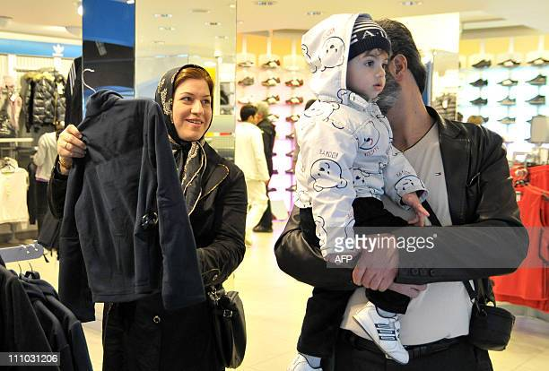 HARUTUNIAN Iranian tourists shop in a store in Yerevan on March 24 2011 More than 20000 tourists from the Islamic republic are expected to visit the...