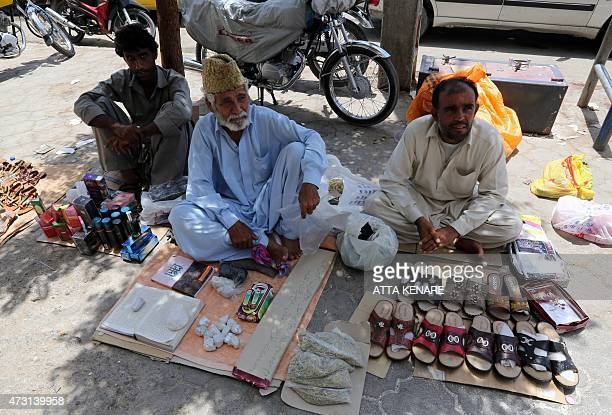 Iranian vendors sell items on the street outside the old bazaar in the southern Iranian coastal city of Chabahar on May 13 2015 AFP PHOTO/ ATTA KENARE