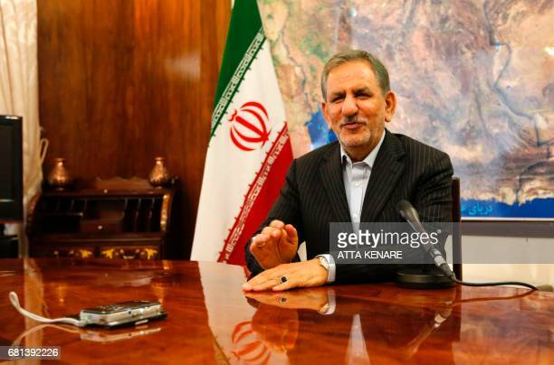 Iranian vicepresident and candidate in Iran's upcoming presidential elections Eshaq Jahangiri gives an interview with AFP in Tehran on May 9 2017...