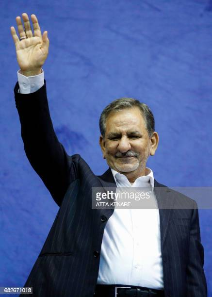 Iranian vicepresident and presidential candidate Eshaq Jahangiri waives to the crowds as he attends a campaign rally for the upcoming presidential...
