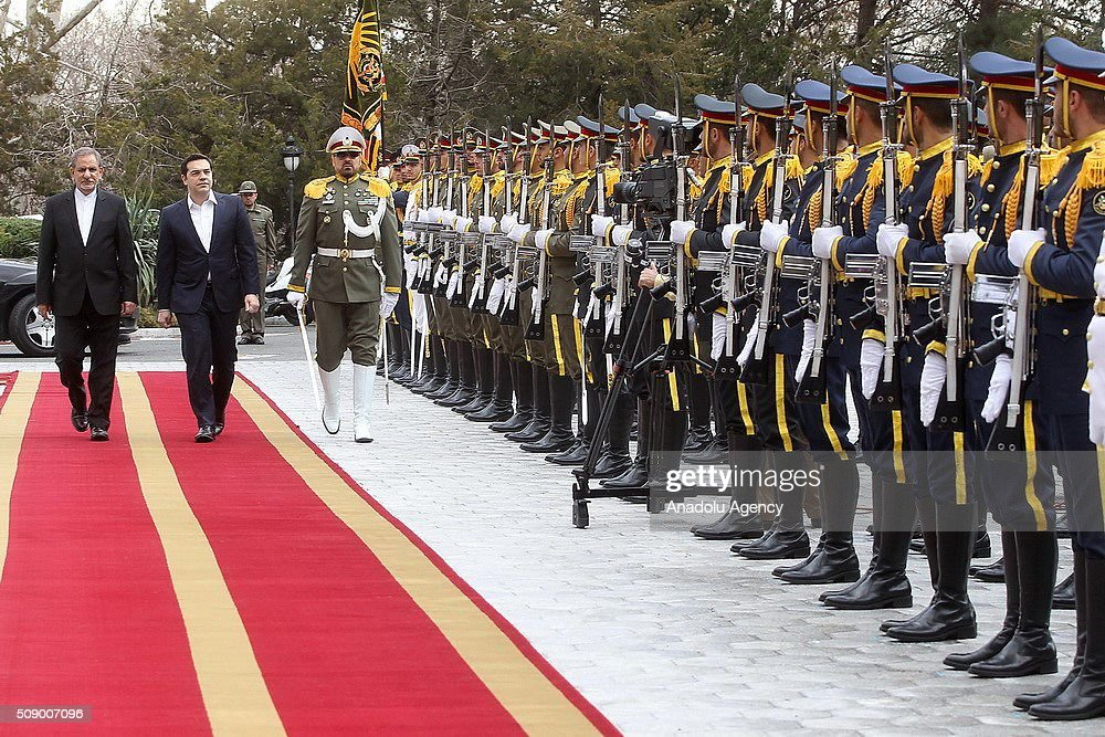 Iranian Vice-President Eshagh Jangiri (L) and Greek Prime Minister Alexis Tsipras (2nd L) inspect the Iranian honor guard during a welcome ceremony in Tehran, Iran on 08 February 2016. Tsipras visits Tehran to meet with Iranian officials.
