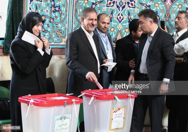 Iranian vicepresident Eshaq Jahangiri and his wife cast their ballots for the presidential elections at a polling station in Tehran on May 19 2017 /...