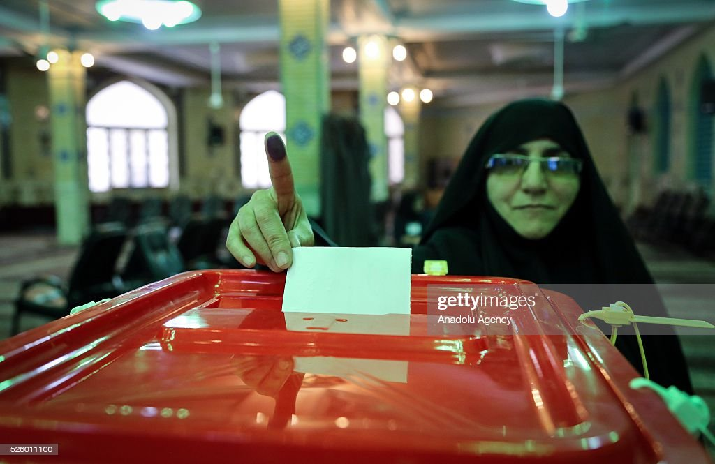 Iranian voter displays her ink-stained fingers during a second round of parliamentary elections at a polling station in Shahriar district of Tehran, Iran on April 29, 2016.