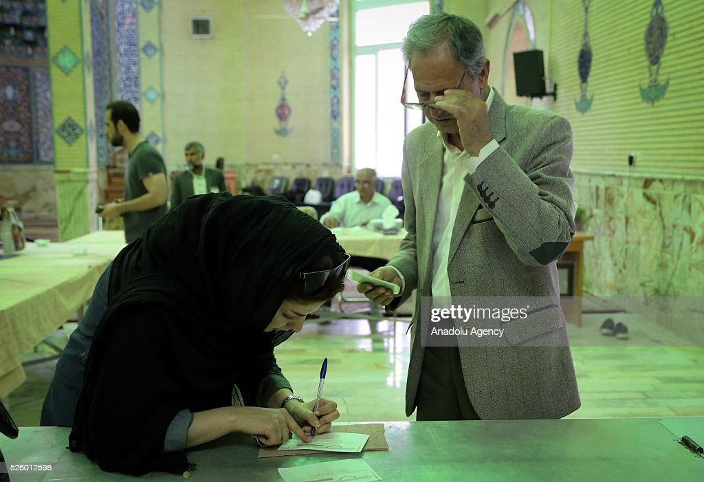Iranian voters are seen during a second round of parliamentary elections at a polling station in Shahriar district of Tehran, Iran on April 29, 2016.