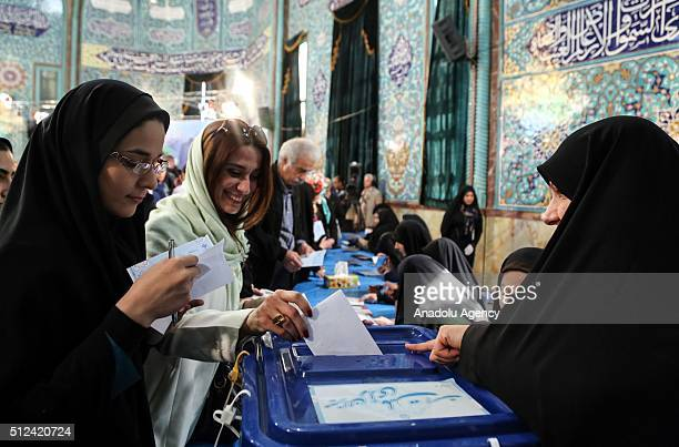 Iranian voters cast their ballots to vote for both parliamentary elections and Assembly of Experts at a polling station in Tehran on February 26 2016