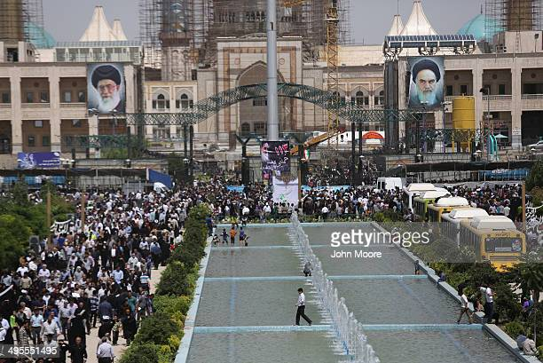 Iranian walk near by portraits of Iran's supreme leader Ayatollah Ali Khamenei and the former Ayatollah Khomeini outside Khomeini's shrine on the...