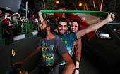 Iranian wave the national flag during celebration in northern Tehran on July 14 after Iran's nuclear negotiating team struck a deal with world powers...