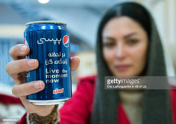 Iranian woman showing a Pepsi can with Persian script isfahan province isfahan Iran on January 5 2016 in Isfahan Iran