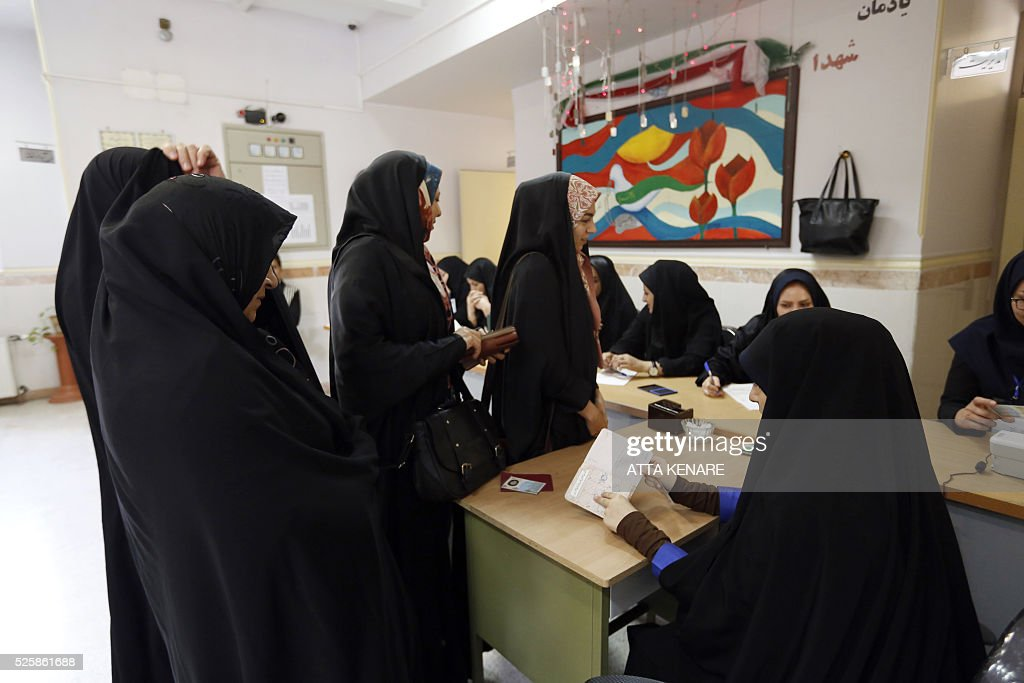 Iranian women arrive to cast their vote in the second round of parliamentary elections at a polling station in the town of Robat Karim, some 40 kms southwest of the capital Tehran, on April 29, 2016. Iranians started voting in second round elections for almost a quarter of parliament's seats, the latest political showdown between reformists and conservatives seeking to influence the country's future. Polling stations opened at 8:00 am (0330 GMT) for the ballot which is taking place in 21 provinces, but not Tehran, because no candidate in 68 constituencies managed to win 25 percent of votes cast in initial voting on February 26. Reformists who backed moderate President Hassan Rouhani made big gains in the first round following Iran's implementation of a nuclear deal with world powers, which lifted sanctions blamed for long hobbling the economy. Conservative MPs, including vehement opponents of the West who openly criticised the landmark agreement that reined in Iran's atomic programme, lost dozens of seats and were wiped out in Tehran where reformists won all 30 places in parliament. / AFP / ATTA
