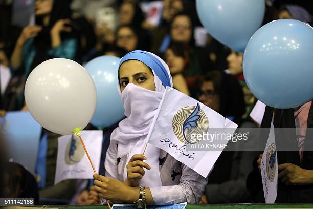 TOPSHOT Iranian women attend a campaign for the reformists for the upcoming parliamentary elections at the Hejab hall in downtown Tehran on February...