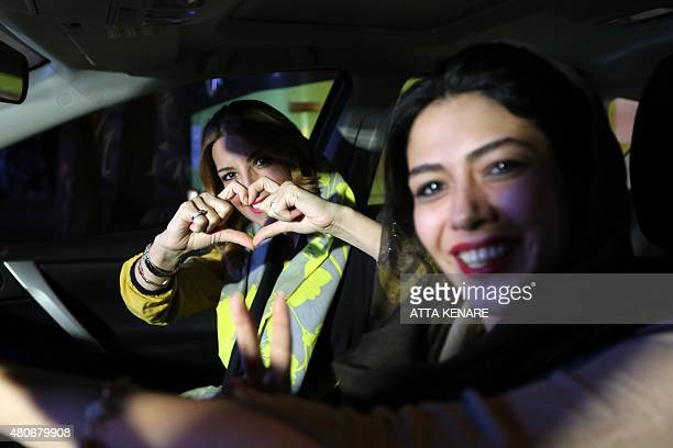Iranian women flash a heart sign during celebration in northern Tehran on July 14 after Iran's nuclear negotiating team struck a deal with world...