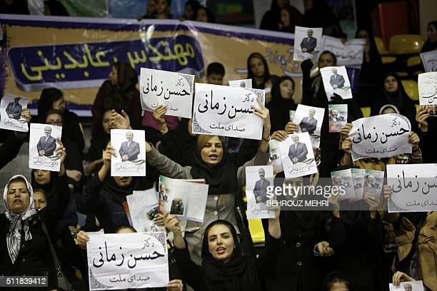 Iranian women hold leaflets of Hassan Zamani a candidate for the upcoming parliamentary elections during a campaign meeting in Tehran on February 23...