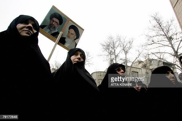 Iranian women holding up portraits of supreme leader Ayatollah Ali Khamenei and his late predecessor Ayatollah Ruhollah Khomeini join a demonstration...