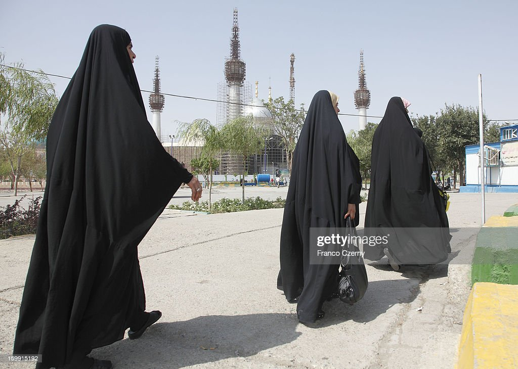 Iranian women in chadors walk at the Holy Shrine mausoleum of Ayatollah Khomeini on August 14, 2012 in Tehran, Iran.