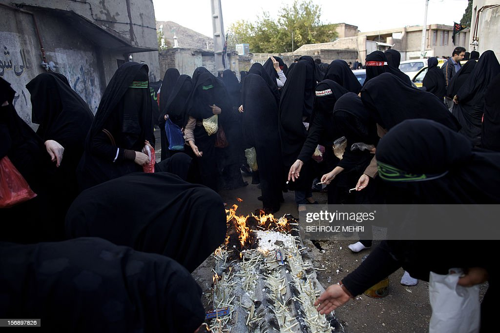 Iranian women light candles during the 'Chehel Manbar' (Forty Pulpits) ritual a day before Ashura, in the city of Khorramabad, 470 kilometres southwest of Tehran on November 24, 2012. Traditionally, Iranian women of Khorramabad city walk barefoot to light candles in 40 designated places in the city centre on the eve of the Ashura, which marks the seventh century slaying of the grandson of Prophet Mohammed, Imam Hussein.