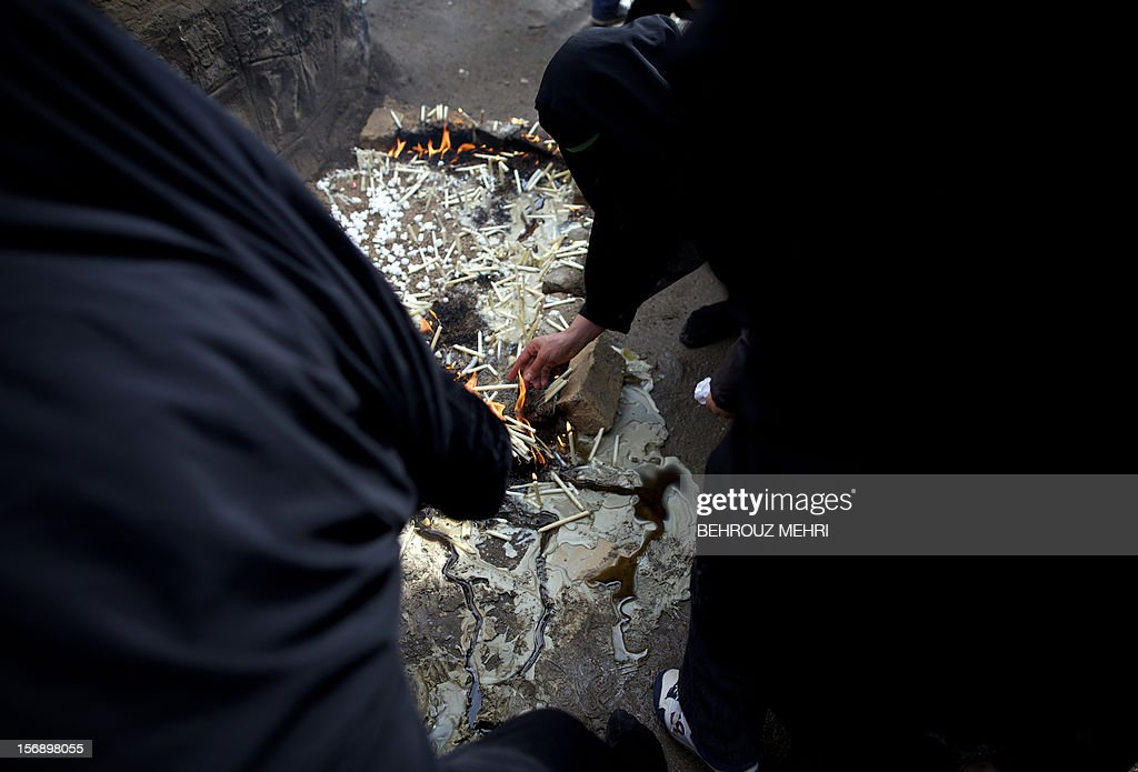 Iranian women light candles during the 'Chehel Manbar' (Forty Pulpits) ritual a day before Ashura, in the city of Khorramabad, 470 kilometres southwest of Tehran on November 24, 2012. Traditionally, Iranian women of Khorramabad walk barefoot to light candles in 40 designated places in the city centre on the eve of the Ashura, which marks the seventh century slaying of the grandson of Prophet Mohammed, Imam Hussein.