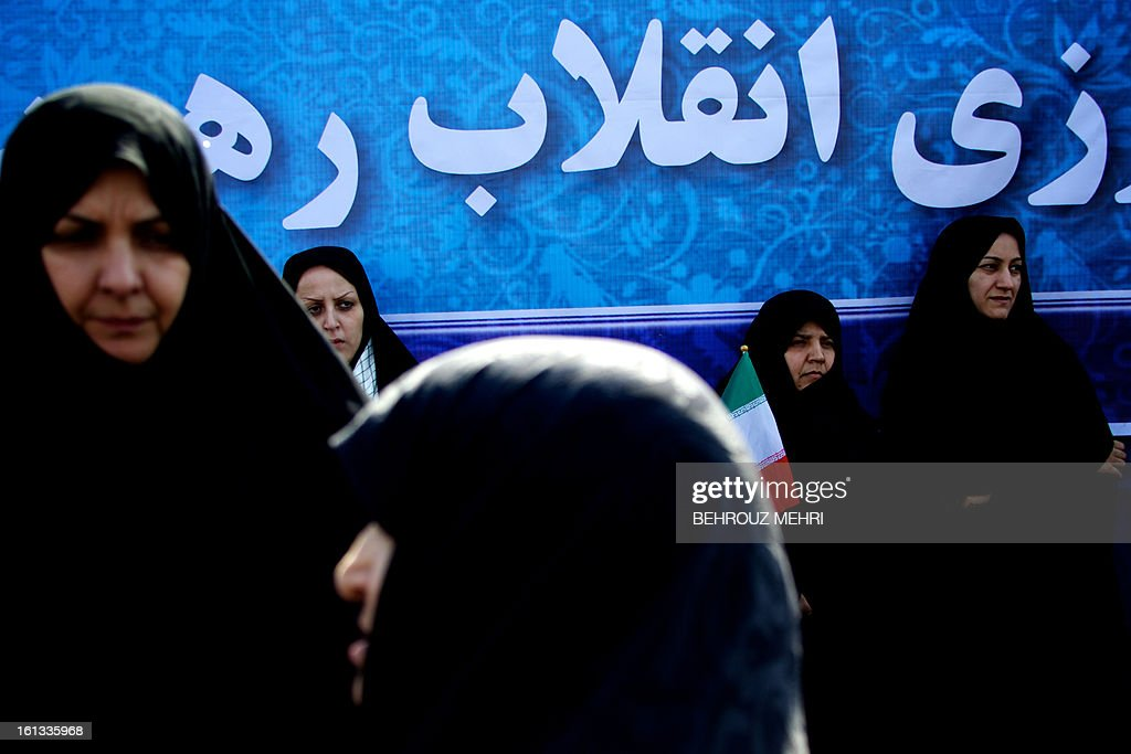 Iranian women listen to a speech by Iran's President during a rally in Tehran's Azadi Square (Freedom Square) to mark the 34th anniversary of the Islamic revolution on February 10, 2013. Hundreds of thousands of people marched in Tehran and other cities chanting 'Death to America' and 'Death to Israel' as Iran celebrated the anniversary of the ousting of the US-backed shah. AFP PHOTO/BEHROUZ MEHRI