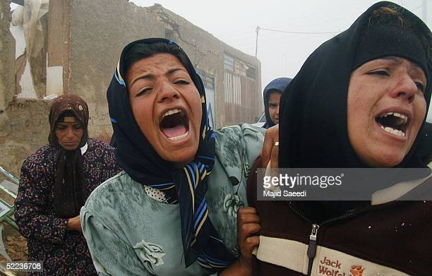 Iranian women mourn for those who died in the earthquake February 24 2005 in the village of Dahoueieh about 700 km southeast of the capital Tehran...
