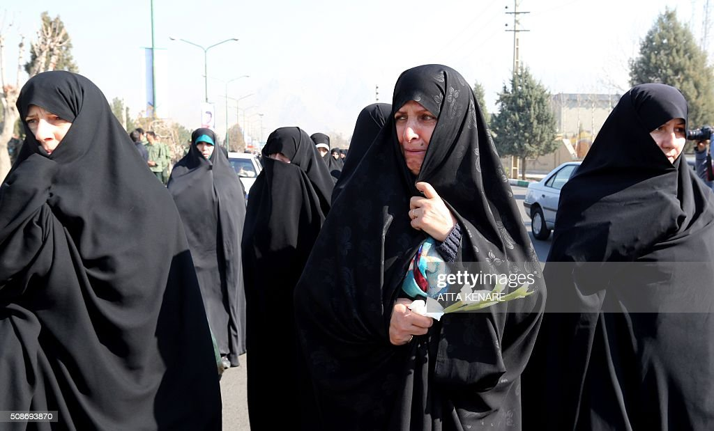 Iranian women mourn on February 6, 2016 in the capital Tehran during the funeral of Iran's Revolutionary Guards Brigadier General Mohsen Ghajarian, who was reportedly killed in the northern province of Aleppo in the fight against the Islamic State (IS) jihadist group, Brigadier General Mohsen Ghajarian of the elite Revolutionary Guards was killed in the northern province of Aleppo, according to the Fars news agency, which is close to the Guards. He was advising pro-government forces in the fight against the Islamic State (IS) jihadist group, it reported, without saying when he died. KENARE