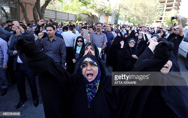 Iranian women shout slogans during a demonstration against Saudi Arabia outside its embassy in Tehran on September 27 four days after some Iranian...